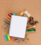 Office tools on cork board Stock Photo