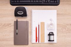 Office tools on the desktop. Top down view royalty free stock photo