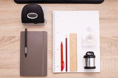 Office tools on the desktop. Top down view royalty free stock photography