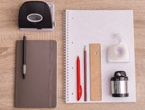 Office tools on the desktop. Top down view stock photography