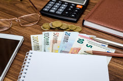 Office tools with empty notebook and euro bills Stock Photography