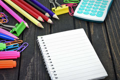 Office tools and notepad on table Stock Photos
