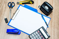 Office tools and paper sheet on wooden table Royalty Free Stock Image