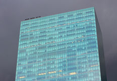 Office Tower in Dark Skies Stock Image
