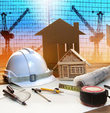 Office tower and home construction plan on architect working tab. Le with modern building and crane background use for civil engineer and architectural backdrop Royalty Free Stock Image