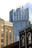 Office tower with old buildings. Modern office tower with old buildings in the foreground Stock Images