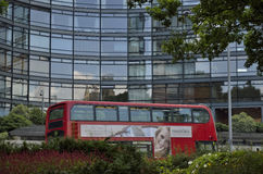 Office tower and red London bus Royalty Free Stock Image