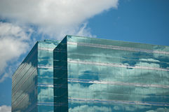 Office Tower Reflecting Blue Sky and Clouds Royalty Free Stock Photos