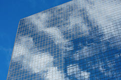 Office Tower Window Reflections. Cloud reflections in the windows of a high rise office tower Royalty Free Stock Image