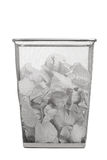 Office trash can with crumpled paper Stock Image