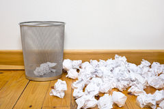 Office trash can on wood floor Royalty Free Stock Image