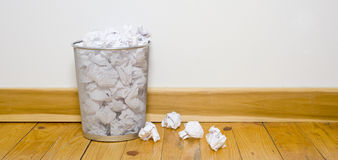 Office trash can on wood floor Stock Photography