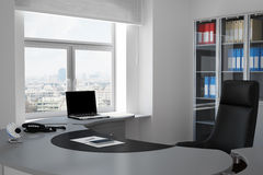 Office with urban view through. Window and grey table