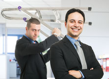Office violence. Angry businessman ready to hit his boss Stock Photography