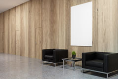 Office waiting area with poster Royalty Free Stock Image