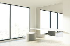 Office waiting area, puffing, window. Gray puffing is standing near a white table in a room with a large mirror and a panoramic window. 3d rendering Stock Photography