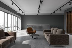 Office waiting room, brown armchairs, reception. Office waiting room interior with loft windows, a concrete floor and brown and gray armchairs standing next to Stock Image