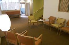 Office waiting room interiors. Beautiful lighting and interiors in an office waiting room Stock Image