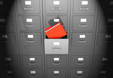 Office wall. Grey office wall of files with red folder in front Stock Images