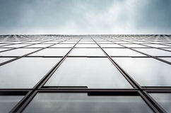 Office wall against a cloudy sky. Architectural detail - office wall against a cloudy sky Stock Images