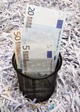 Office wastebasket and paper. Office wastebasket with euro and paper as background stock images