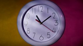 Office white clock on colorful background. Office close up of an white office clock on colorful background with clipping path stock footage