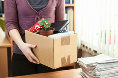 Office white collar worker with things collected in box Royalty Free Stock Photos