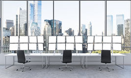 Office with 24 white monitors, processing data, trading, new yor Royalty Free Stock Photography