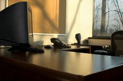 Office by the window. At sunset Royalty Free Stock Image