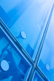 Office Window Close Up. Close up of office building windows with blue glass royalty free stock photography