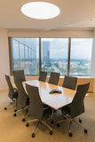 Office window view from a meeting room with a speaker phone Royalty Free Stock Image