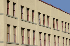 Office windows. The exterior of a large urban commercial building with lots of windows Royalty Free Stock Image