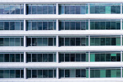 Office windows. Section of exterior of a modern office building with repetitive pattern of windows Stock Photos