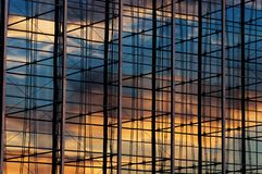 Office windows. Steel and glass office windows with reflections Stock Images
