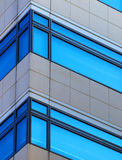 Office windows. Corner of office building with bright blue windows royalty free stock photography