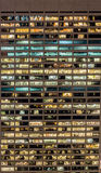 The office windows illuminated at night Royalty Free Stock Photography