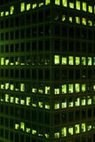 Office windows lit at night royalty free stock images