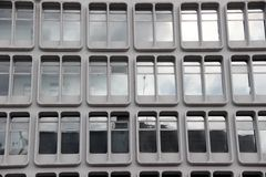 Office windows Manchester. Modernist office windows in Manchester Stock Image
