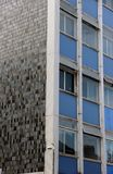 Office windows Manchester. Office windows and tiled wall in Manchester Royalty Free Stock Photos