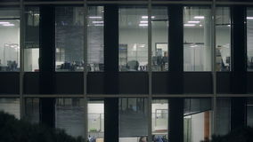 Office Windows night shift, floor in business center, the room is bright stock video