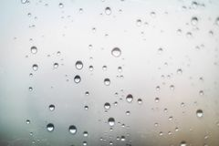 Office Windows with raindrop with blurry in the corner. Office Windows with raindrop with blurry in the corner royalty free stock photo