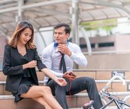 Office woman business man couple lover talking flirting sit royalty free stock photography
