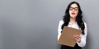 Office woman with a clipboard. On a solid background Royalty Free Stock Photos
