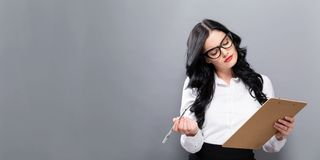 Office woman with a clipboard. On a solid background Royalty Free Stock Image