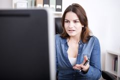 Office Woman Facing at Computer with Palm Up Royalty Free Stock Photography