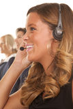 Office woman headset smile side Royalty Free Stock Photography