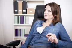 Office Woman on her Chair Thinking of Something Stock Photo