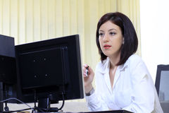 Office woman at her desk stock photo