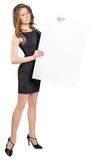 Office woman holding a large blank billboard Royalty Free Stock Photo