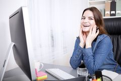 Office Woman Leaning on Table with Hands on Face Stock Image